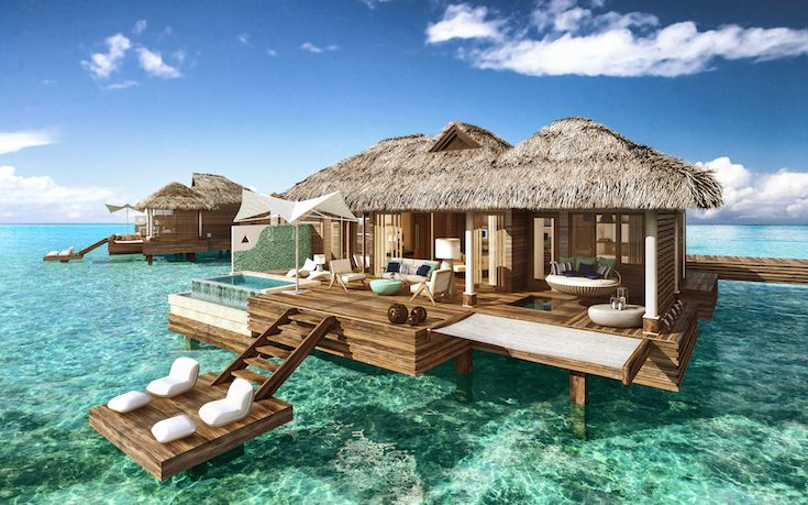 Perched on a deck floating above turquoise waters, our over-the-water villas feature see-through glass floors, a Tranquility Soaking Tub, an over-the-water hammock for two and a private infinity plunge pool for countless ways to enjoy the water. #Paradise #Travel #Vacation #Caribbean | Sandals Resorts | Jamaica