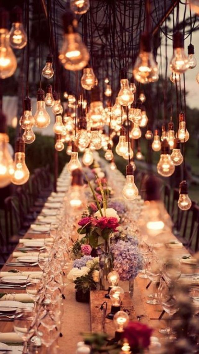 Perfect idea for a summer garden party, love how the lightbulbs hang above the table