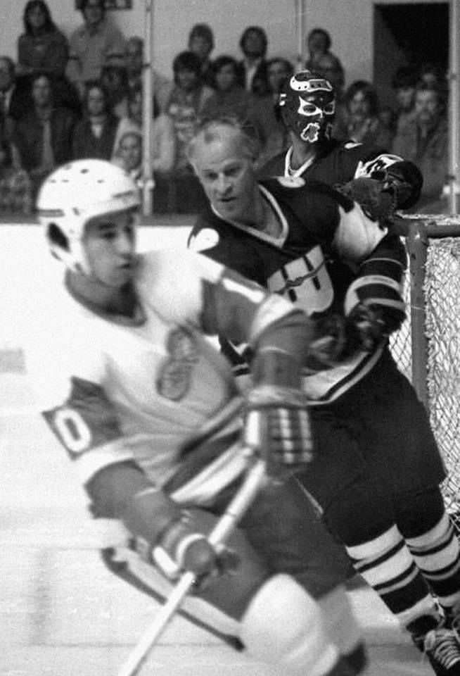 NHL vs. WHA exhibition game: Dale McCourt for the Red Wings, Gordie Howe and John Garrett for the New England Whalers. Garrett is still wearing the mask he wore with the Birmingham Bulls.