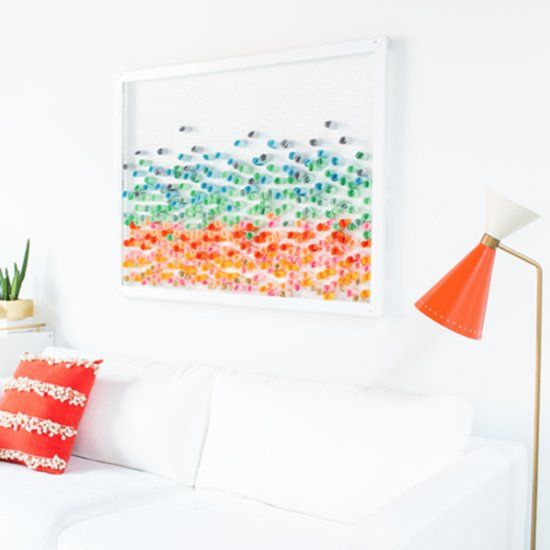 This DIY paper wall art is colorful, fun and will be the centerpiece to any room.