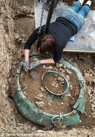 The major find so far has been a large bronze-decorated wine cauldron, most likely made by Greek or Etruscans craftsmen