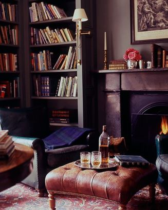 So cozy it just invites one to come sit by the fire, put your feet up and unwind.  Such an unusual color with the red also, but it works beautifully (Irish country house -- Tricia Foley)