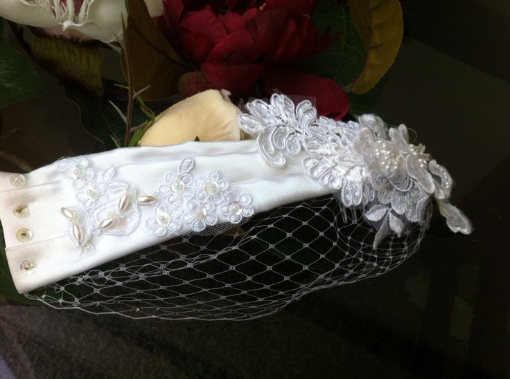 Crisp white satin wrap with detailed lace and a small sweep of netting. www.margotarderndesigns.com