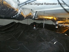 Rainwater Harvesting - The Original Rainwater Pillow Liner    In a residence in St. Croix USVI, the Original Rainwater Pillow Liner is installed in three existing concrete cisterns under the home. Total water storage capacity of 30,000 gallons. The Liners help maintain water quality and reduce humidity in the home.    www.rainwaterpillow.com: Photo