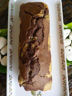 Saveurs et Expériences à l'île Maurice: Cake Marbré au Lait de Coco & Cacao__________________ 150gr de sucre demerara 2 oeufs 250gr de farine T55 1 sachet de levure chimique 20cl de lait de coco (recette ici ) 2 cuillères à café d'essence de vanille 1 cuillère à soupe de rhum 3 cuillères à soupe de cacao en poudre.