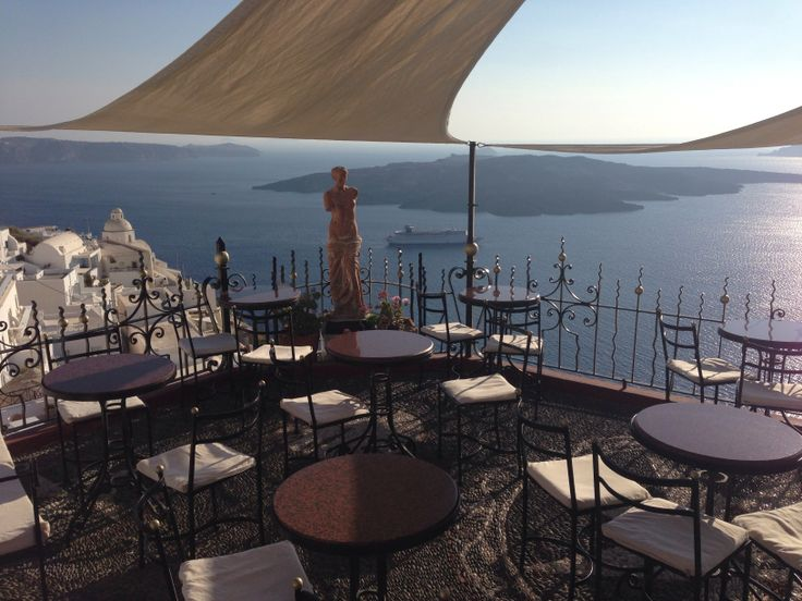 Palia Kameni Cocktail Bar Fira, Santorini, Greece   The most beautiful bar I've ever been to.