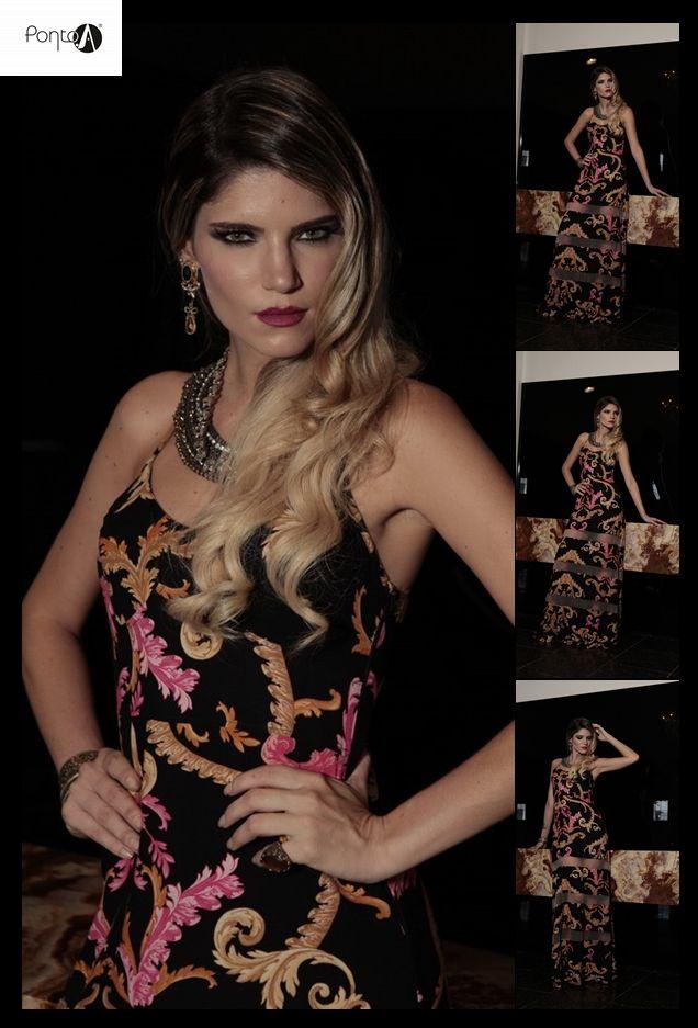 Vestido longo com estampa de fundo escuro com transparências. #maravilhoso#luxo#glam@Pontoamoda