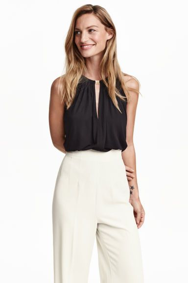Sleeveless jersey top: Wide sleeveless top in soft, gently draping jersey with a sheen, with a V-neck with a metal clasp at the top and pleats at the neck.