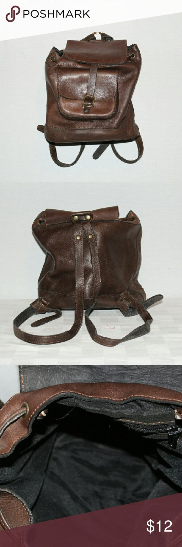 Small Leather Backpack/Bucket Bag Rustic Looking Leather Backpack/Bucket Bag, some minor scuff marks, that give this packpack character,  clean inside, no  rips in lining, magnetic fastener, with draw string. 1 outside pouch with magnetic fastener,  1 zippered pouch inside. Dimensions are length 9.5 inches, depth 9 inches, width 4 inches. unknown  Bags Backpacks