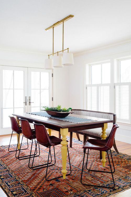White painted ceiling with pendant lights hanging, white painted wall, dark wood table & bench with cushion, dark brown chairs, brown hardwood floor with nice rug  Source: https://www.houzz.com/photo/52759097-lexington-farmhouse-southwestern-dining-room-boston