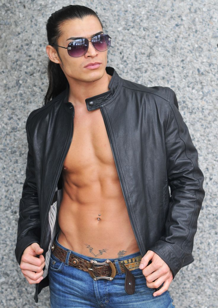 """Carrying the aura of a rock star, dressed in jeans and black leather, he strolls toward the elevators with a slight roll of his large shoulders. The long black hair is combed back into a ponytail, revealing a single earring in his right lobe. Tall and confident, he glides into the group of hens like a hot knife in butter, inducing awestruck silence and a timid retreat from a few of the women. """"C'mon, it's your chance to meet him!"""" Laurie squeals, practically jumping up and down with…"""