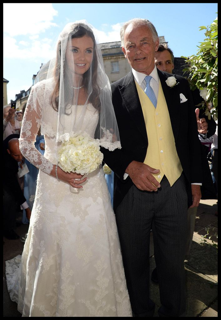 Lady Natasha Rufus Isaacs arrives with her father for her wedding to Rupert Finch at the Church of St. John the Baptist in Gloucester.