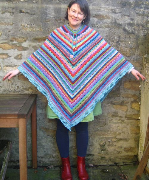 "The pattern for this poncho (which I have named the ""Home Poncho"") is simple but effective, and a little different from the usual ""granny stripe"" type ponchos that are out there. In a nutshell, the pattern consists of two rows of trebles, followed by a more open row which is a {1 treble, skip 1 stitch, chain-1} repeating pattern. There are two increase points at the centre front and back which creates the classic poncho V shape."