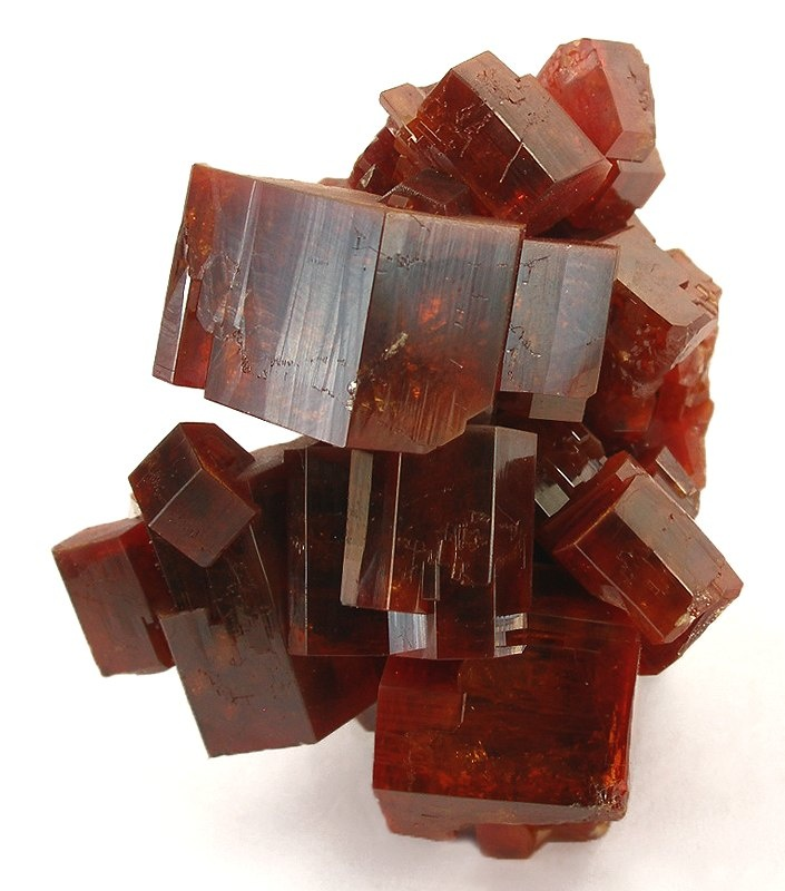 + Vanadinite: Vanadinite is one of the most striking minerals, with its stunning bright-red and orange crystals that are perfectly formed and look almost surreal. This mineral is truly a marvel of nature.    Vanadinite is a member of the Apatite group, a group of isomorphous hexagonal minerals. It is similar in structure and appearance to Pyromorphite and Mimetite, and may be partially replaced by those minerals. The intermediary member between Mimetite and Vanadinite is known as Endlichite.