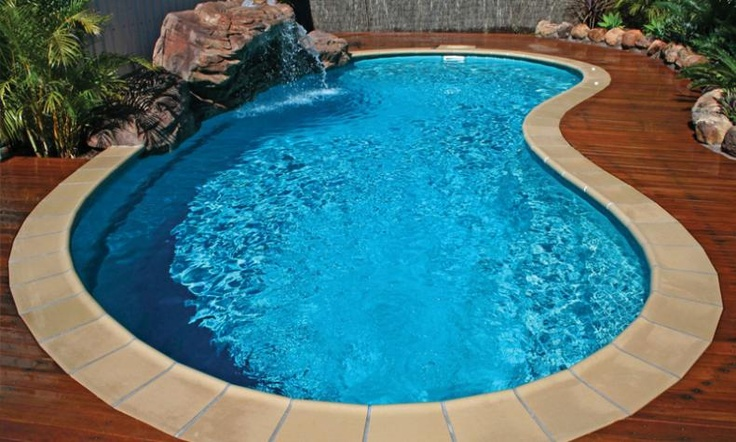 Tuscany Style Fiberglass Pool With Stone Coping And Wood
