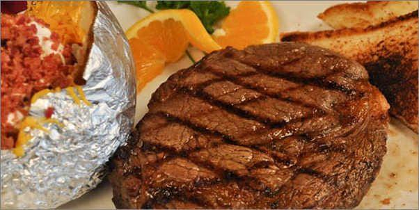 Rib Eye Steak with Loaded Baked Potatoe T-Bone Tom's Steakhouse Restaurant on Diners, Drive-Ins & Dives Kemah, Tx
