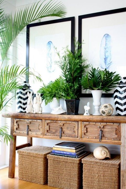 Playing with symmetry, scale, pattern and texture - chunky rustic console table and large-scale art grounded big storage baskets and lots of greenery. |Pinned from PinTo for iPad|
