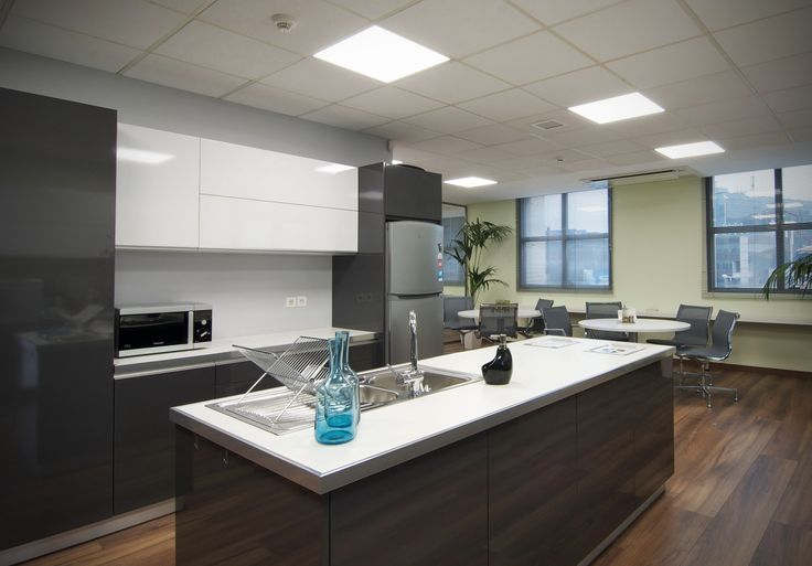 Kitchen with glossy, white and grey, lacquered cabinets and matte white countertop, designed by AkPraxis for the new Offices of Loadline.