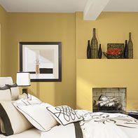 Bright yellow bedroom in Benjamin Moore paint.