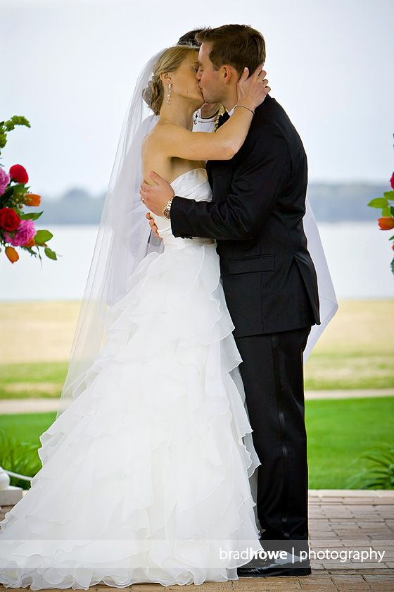 Bride and groom kiss during their wedding ceremony at the ...