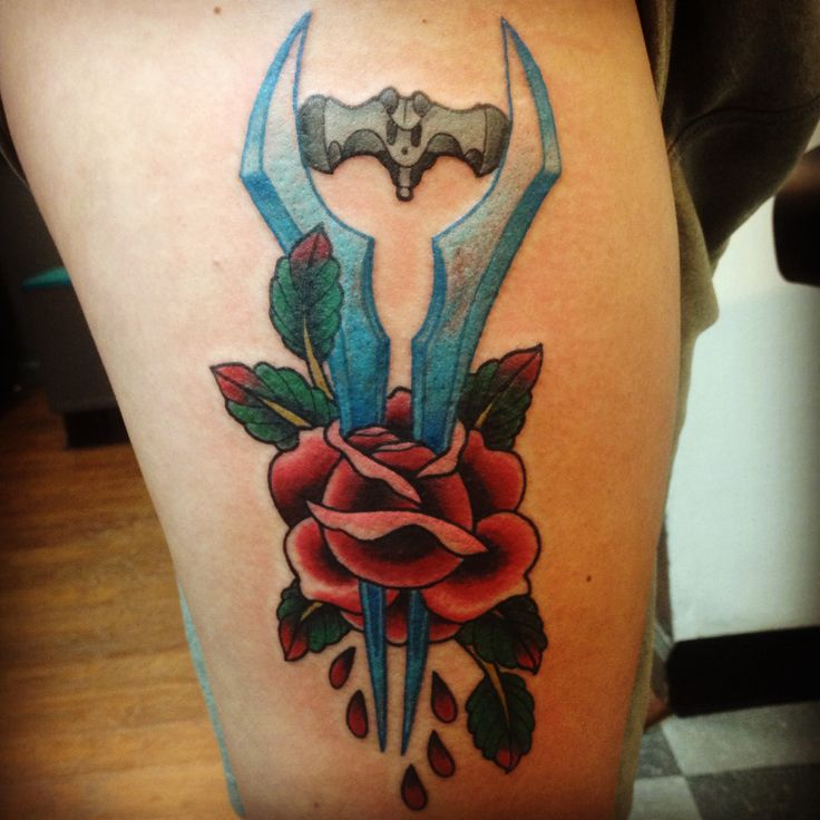Halo tattoo. Energy sword. Thigh. Rose. Blood. Fun.