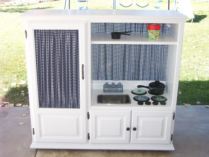 play kitchen for my grand babies....I made it from an old entertainment center :)