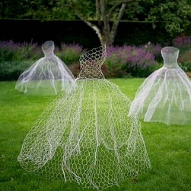 Chicken wire dresses+glow in the dark paint = ghosts! Hell Yeah!  I want to use this for a window display at our store...