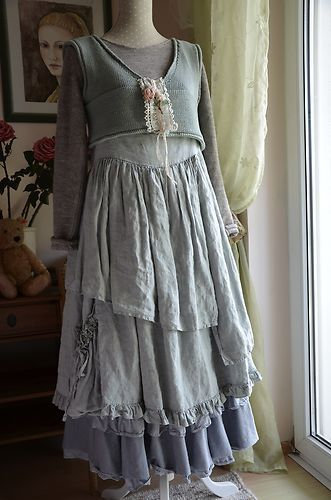 short jacket over dress with ruffled skirt- I like the idea with less ruffles...