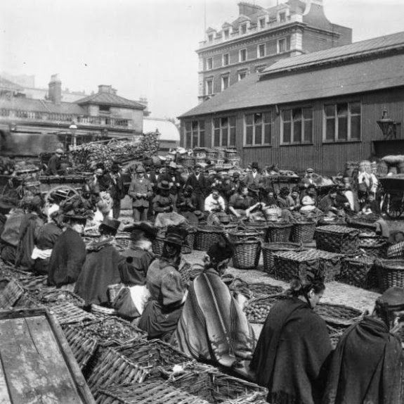 Old Pictures of London in Victorian Era - circa 1890 - Covent Garden women shelling walnuts.