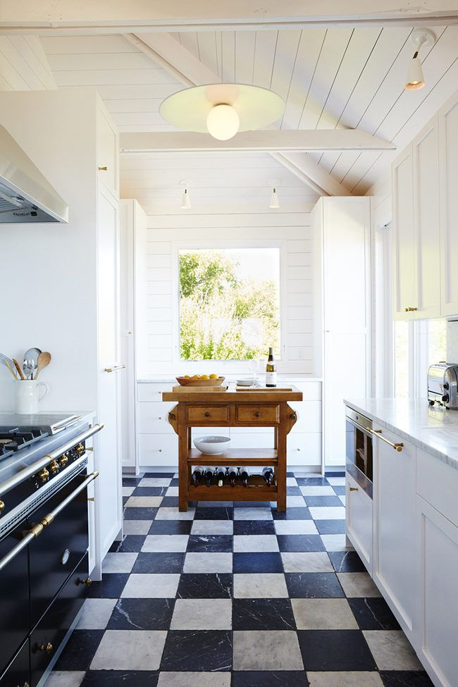 bright white kitchen with a charming checkerboard floor