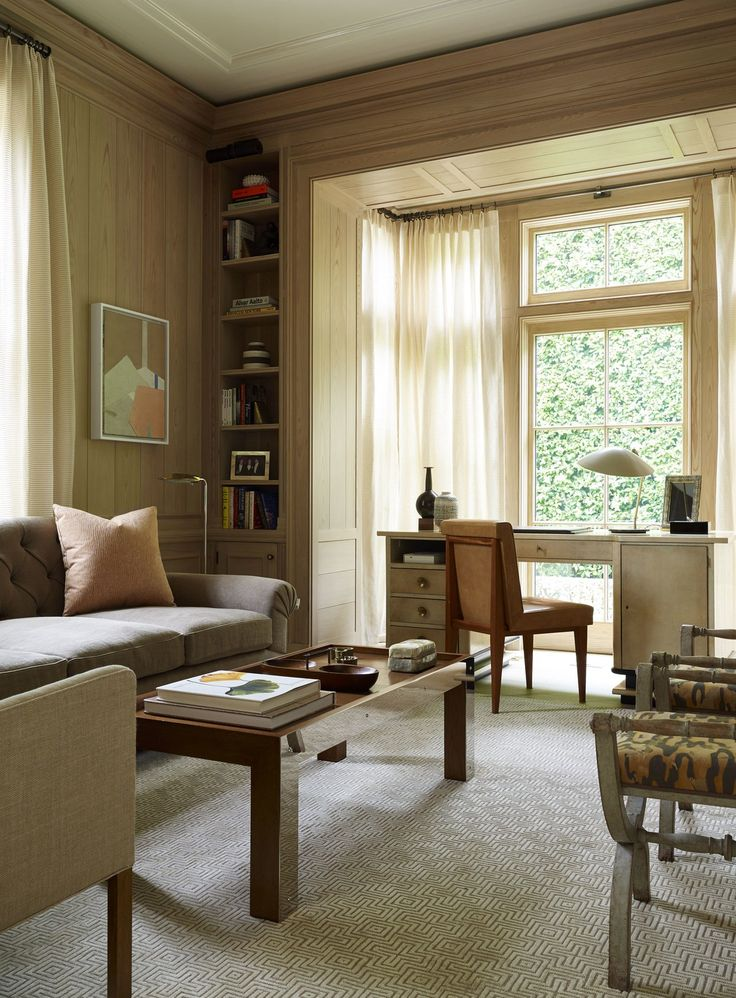 The library's handsome millwork and paneling is made from clear cypress, a more pristine alternative to pecky cypress, which is common to the region; the coffee table is a custom creation by Ferrer. In front of the window is an Art Deco parchment desk.