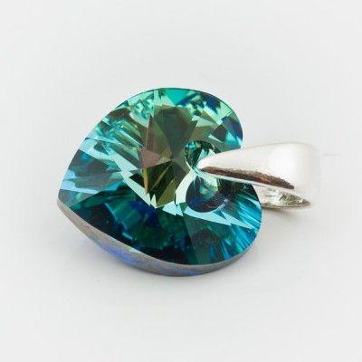 Swarovski Heart Pendant 10mm Bermuda Blue  Dimensions: length: 1,4cm stone size: 10mm Weight ~ 0,72g ( 1 piece ) Metal : sterling silver ( AG-925) Stones: Swarovski Elements 6228 10mm Colour: Bermuda Blue 1 package = 1 piece Price 5.49 PLN