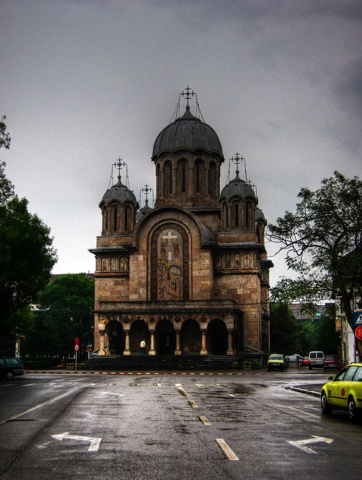 """Hunedoara Orthodox Cathedral is dedicated to """"Saint Constantine and Helena and Pious Parascheva"""" and was built in Byzantine style of brick brought from Santimbru, according to the project of architect Dumitru Berechet in Bucharest."""
