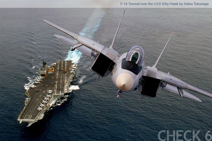 F-14 Tomcat. Dominant in its time and an iconic design forever. This was the plane that started it all for me. (CV63 USS Kitty Hawk in background)