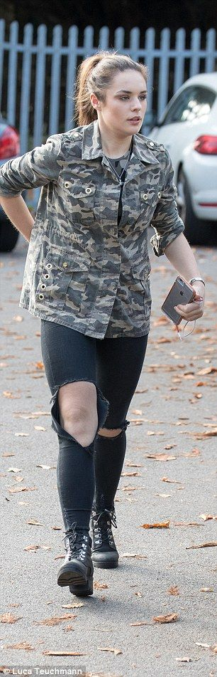 Simple look:Sam Lavery stuck with her fellow girls' style as she rocked a camouflage jacke...