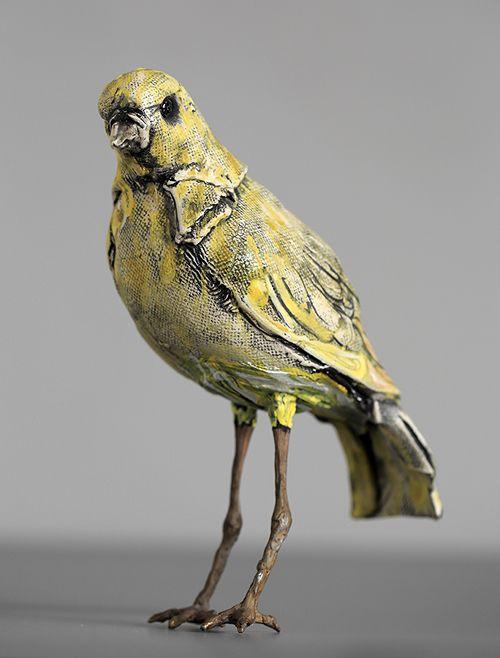 Tall-legged yellow bird small