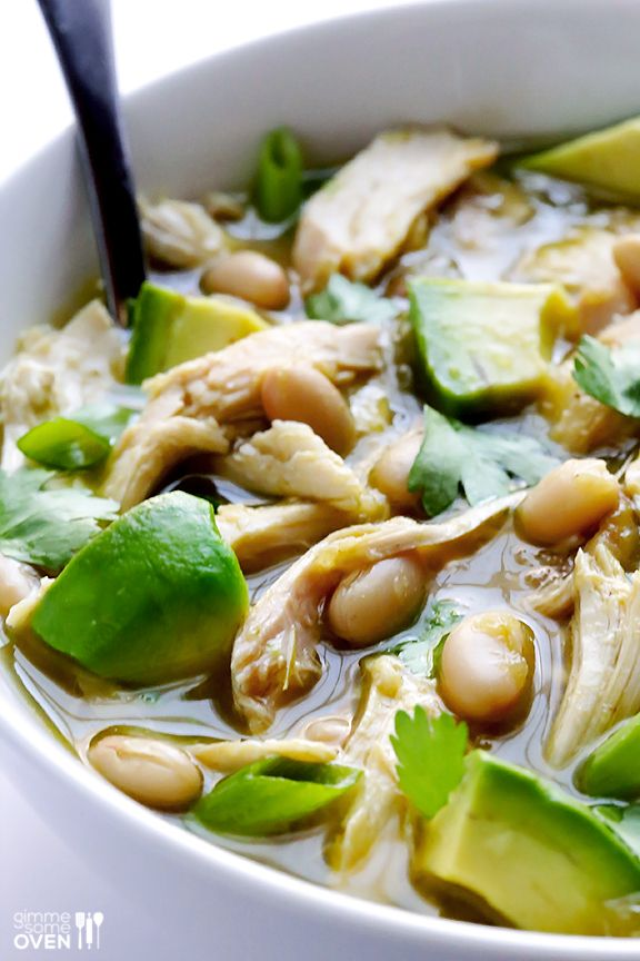 Easy White Chicken Chili - chicken broth, cooked shredded chicken, white beans, salsa verde (includes recipe for homemade - tomatillos, serrano or jalapeno peppers, garlic cloves, fresh cilantro, white onion, lime juice, salt), ground cumin, optional toppings (avocado, fresh cilantro, shredded cheese, green onions, sour cream, tortilla chips...)