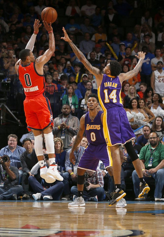 Oklahoma City's Russell Westbrook (0) shoots in front of Los Angeles' Nick Young (0)and Brandon Ingram (14) during the NBA game between the Oklahoma City Thunder and Los Angeles Lakers at the Chesapeake Energy Arena, Sunday, Oct. 30, 2016. Photo by Sarah Phipps, The Oklahoman
