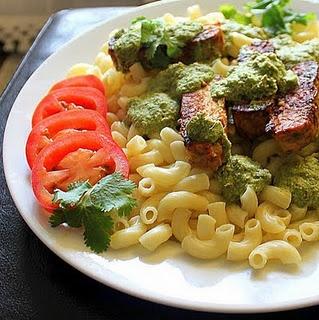 Pasta with Spicy Blackened tempeh with cilantro almond pesto.