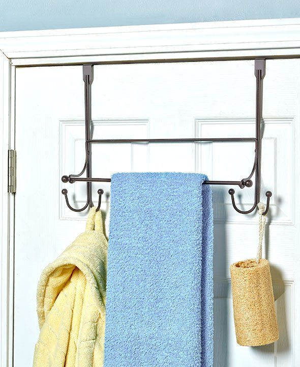 Hang bathrobes, towels and clothing that needs drying on this Over the Door Towel Rack with Hooks. Easily slipping over almost any door, it features