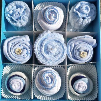 A special gift - cupcakes made from baby clothes & a keepsake box. Perfect for baby shower or new baby gift!