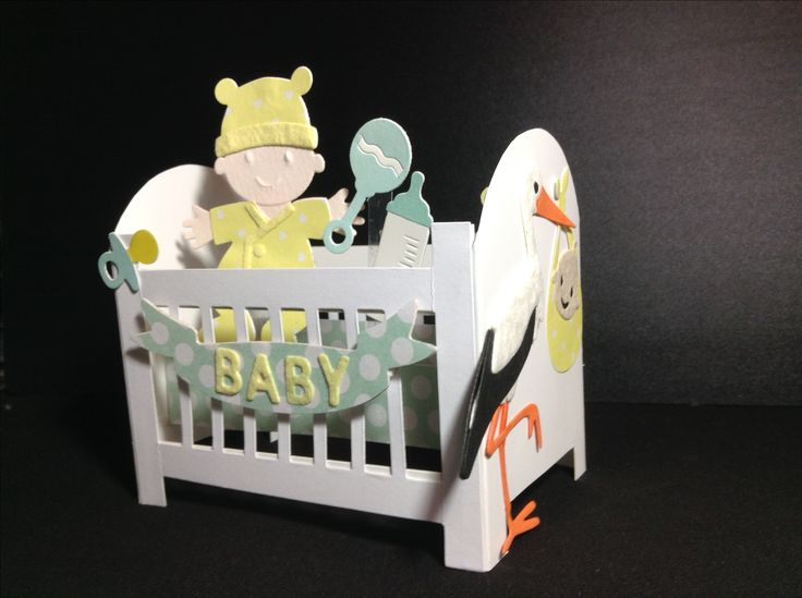 Baby cot card, handmade cot, various cutting dies used to make baby and the stork ( cut out and build) different papers, kept it to gender neutral colours