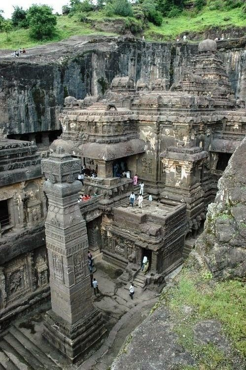 Ellora Caves in India carved out of a solid rock-bluff  & is one of the most unusual things I have seen