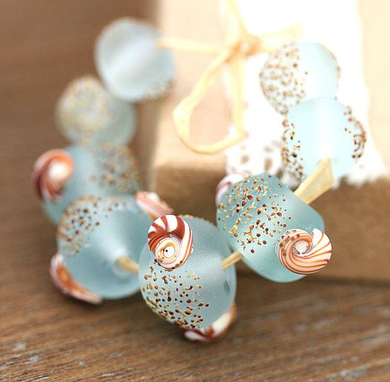 lampwork glass beads in pale aqua with shells and a touch of sand these handmade