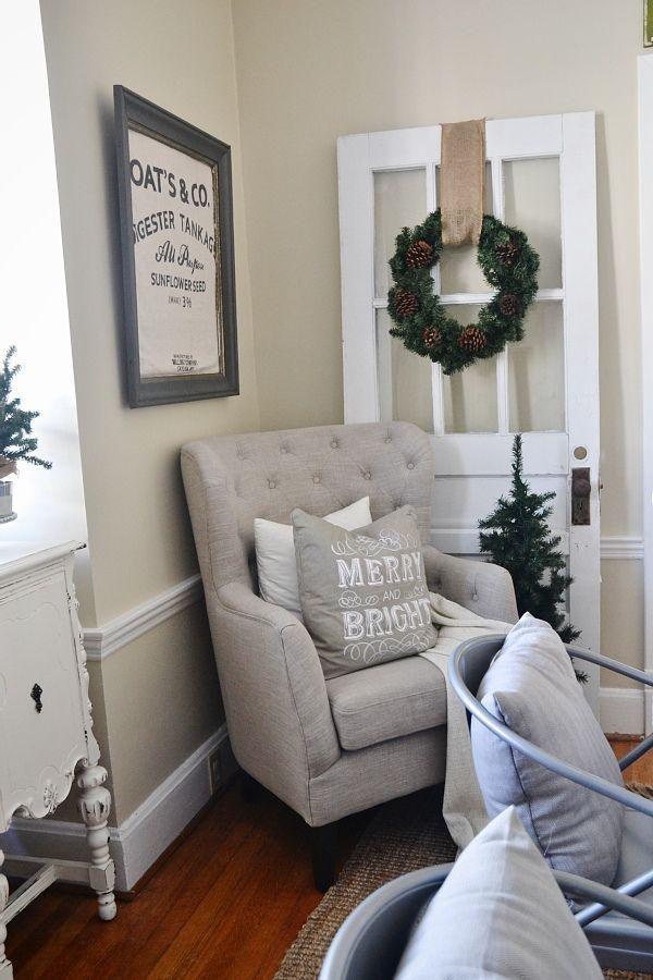 neutral Christmas decor - tufted chair & a lovely door with a simple wreath.