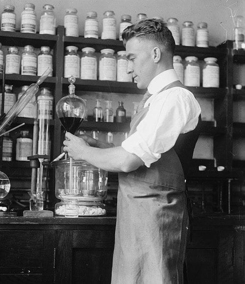 vintage doctor researcher working with blood in lab