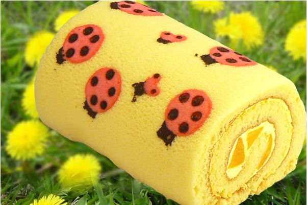 Lady Bug Mango Roll Cake - Yellow Pumpkin (company name) I guess this roll cake doesn't have any pesticide on it ;) Yay to organic! This cute roll cake with lady bugs crawling all over has mango bits and mango cream rolled inside.  Available at the Yellow Pumpkin store at Nisshin City, Aichi-ken; also available for purchase online within Japan.