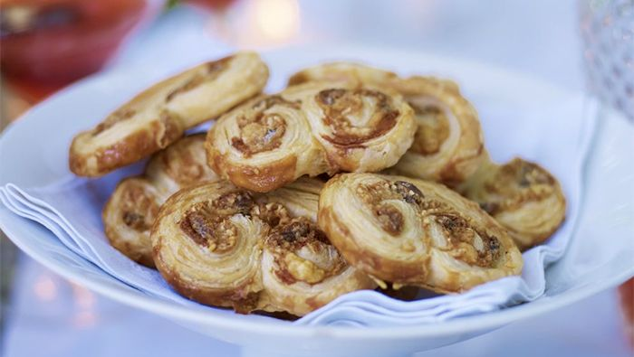 Learn how to bake perfect puff pastry palmiers, with tips on rolling out the distinct shape and ideas for sweet and savoury flavours.