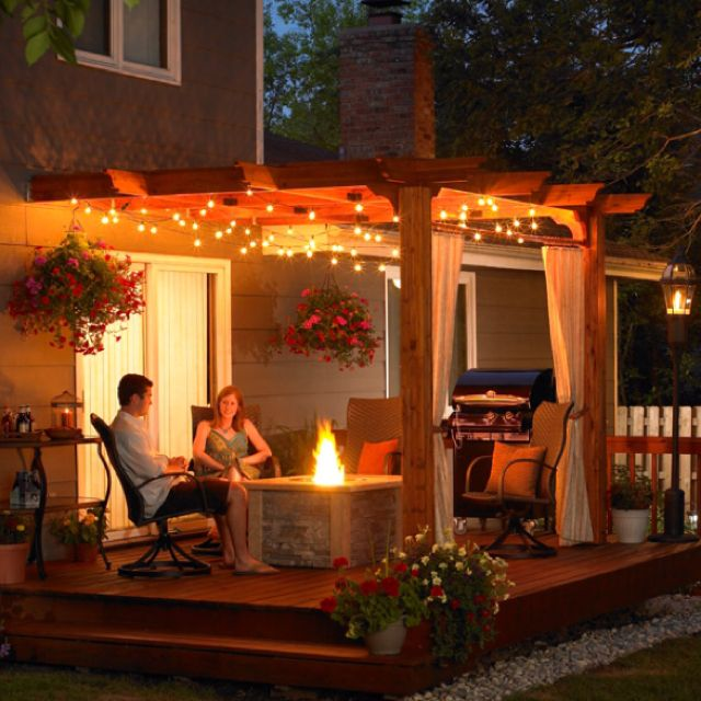 Outside patio idea - like the lighting. Looks realistic we could do this. Like the pergola.