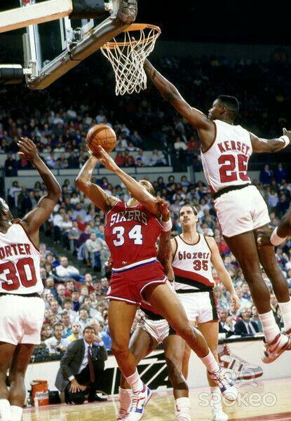 Charles Barkley is a one man gang on the boards against the Blazers' Terry Porter, Clyde Drexler, Richard Anderson, and Jerome Kersey in Portland.